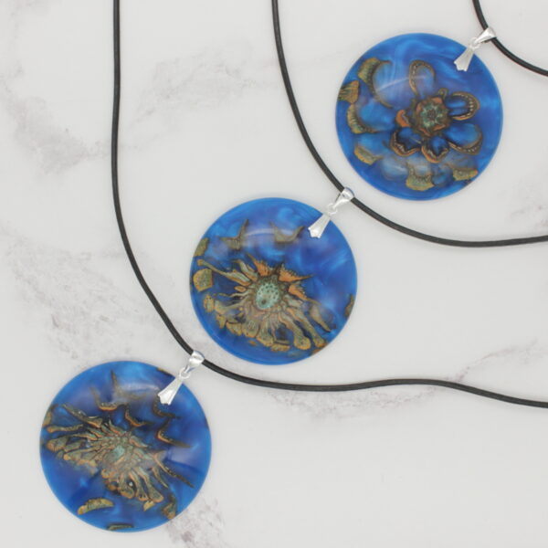 """Island"" wood and resin pendants"